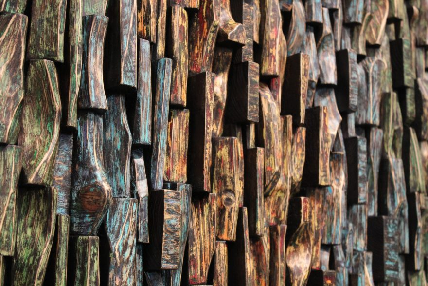 Eco-friendly design concept, recycled wood blocks art with richly textured surface and abstract acrylic painting