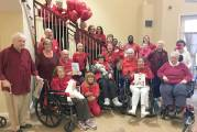 Coachman Square At Woodbridge Making 100 Little Red Hats For Local Babies