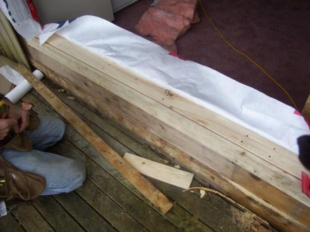 Replacing rotten wood.