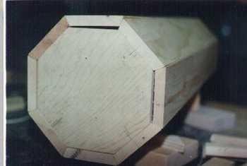 Woodworking a wooden pedestal column.
