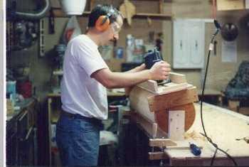 Woodworking a column.