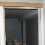 Building up stock door trim.