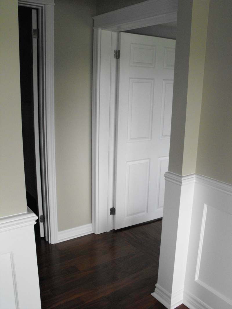 DIY wainscot and walnut flooring.