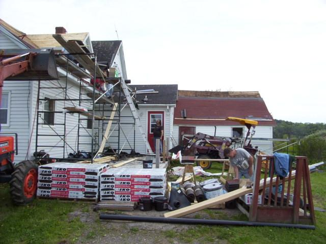 Reshingling a roof.