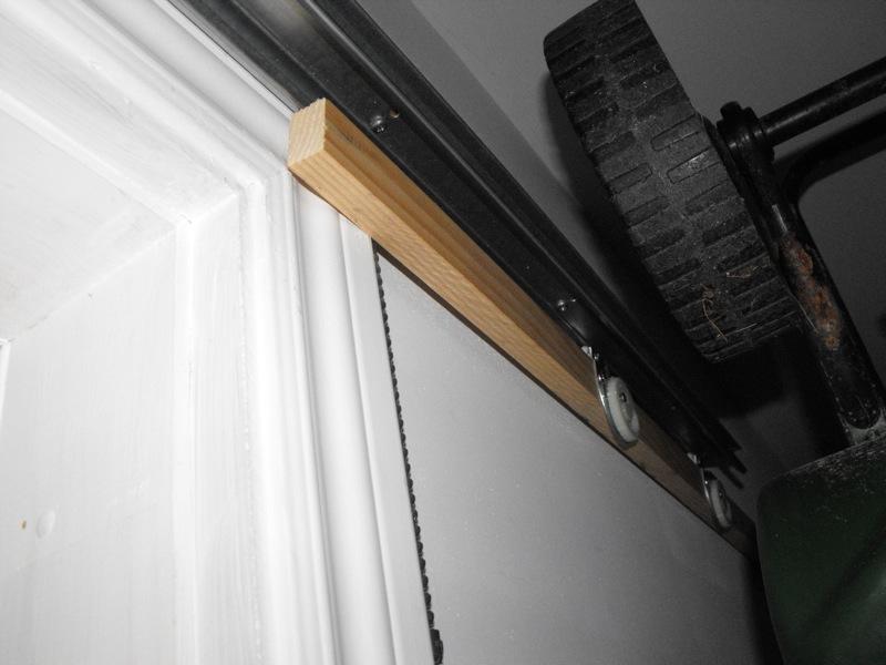 Test fitting a sliding screen door.