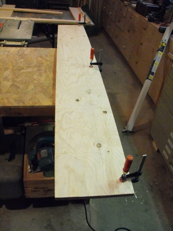 Cutting the plywood.