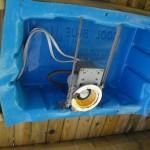 Builder installs under deck lighting