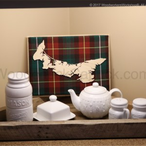 Wood map of Prince Edward Island with tartan background