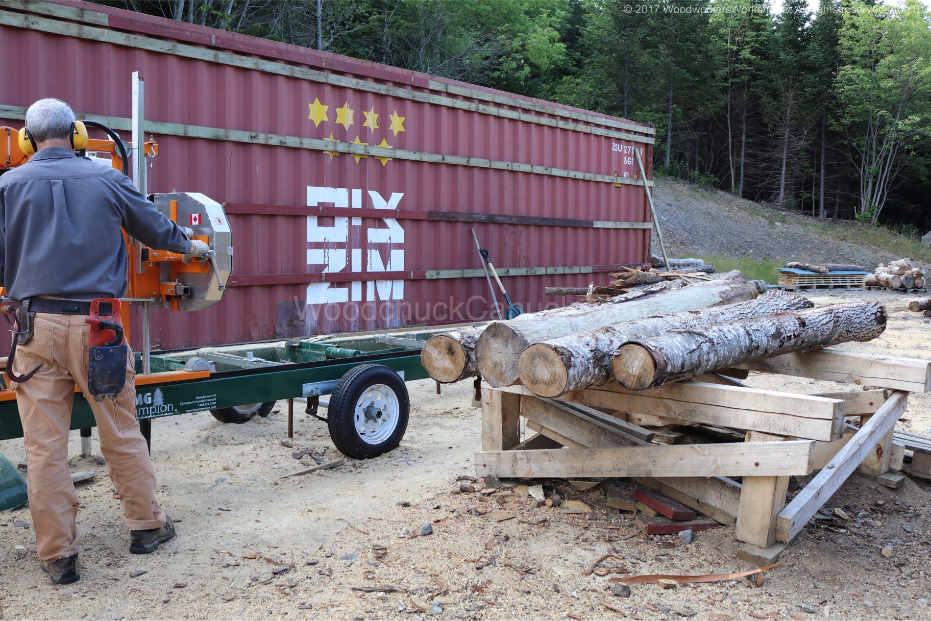 Jim milling logs.