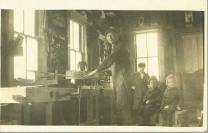 Carpenter and children in the workshop