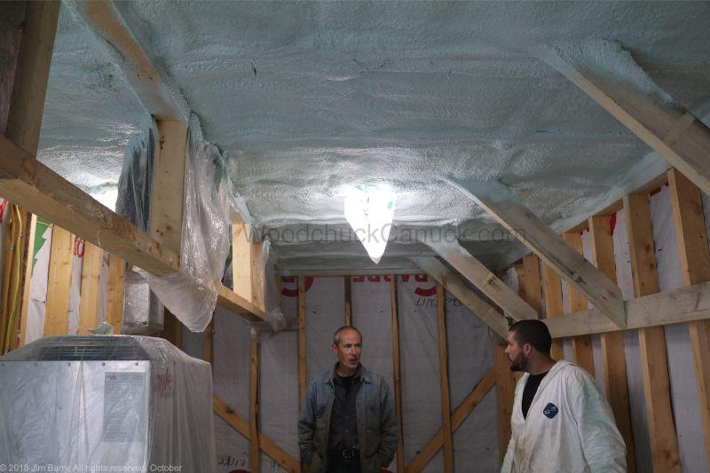 Spray foam insulation in kiln building.