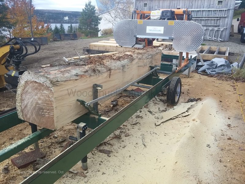 """Saw milling a 14x14"""" pine cant."""
