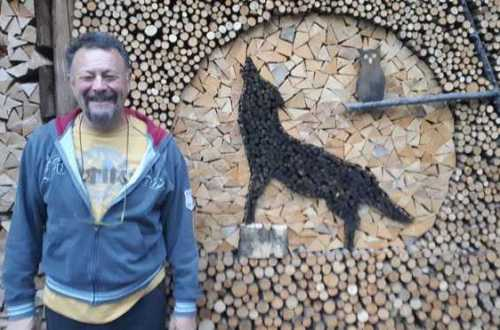 Creative firewood art, wolf howling at the moon.