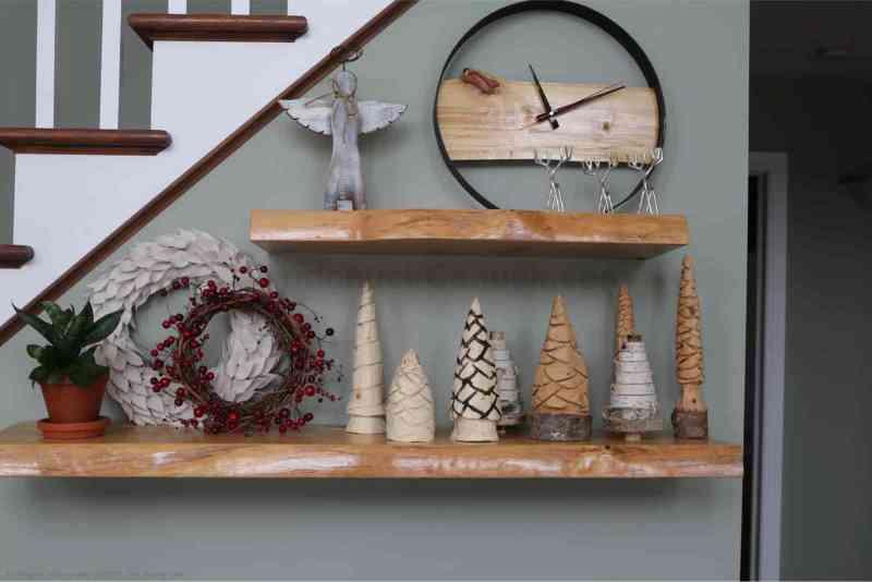 Carved Christmas tree scene.