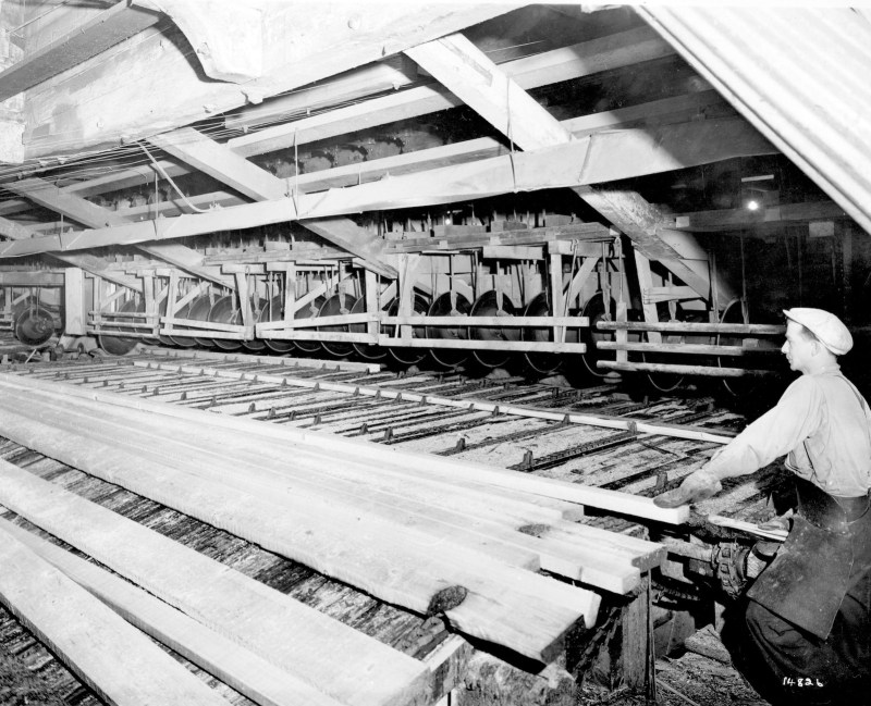 1943 Interior of sawmill showing cut-off saws