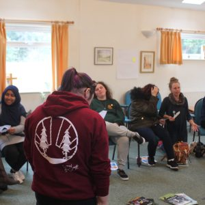 Adult volunteers n a circle in discussion