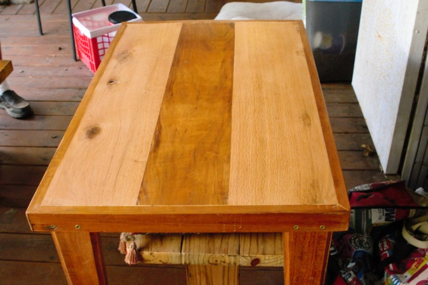Mixed wood occasional table $65.00