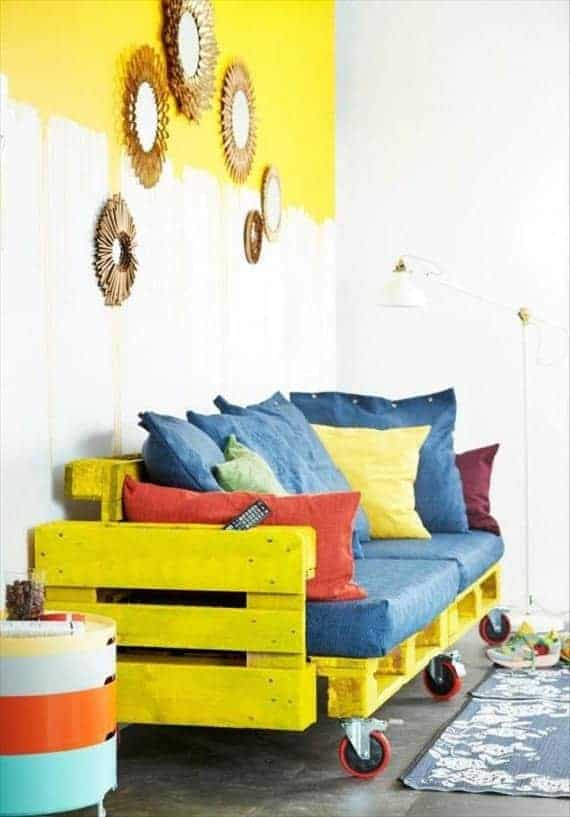 yellow-painted-pallet-sofa-with-red-wheels