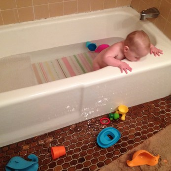 Speaking of time passing quickly, I can hardly remember what it was like before Rowan discovered he could throw things out of the tub.