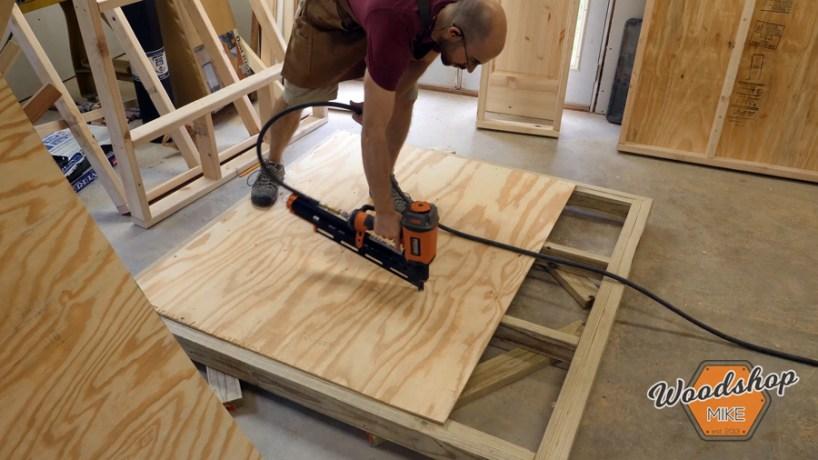 installing chicken coop sub floor _ How to make a DIY chicken coop
