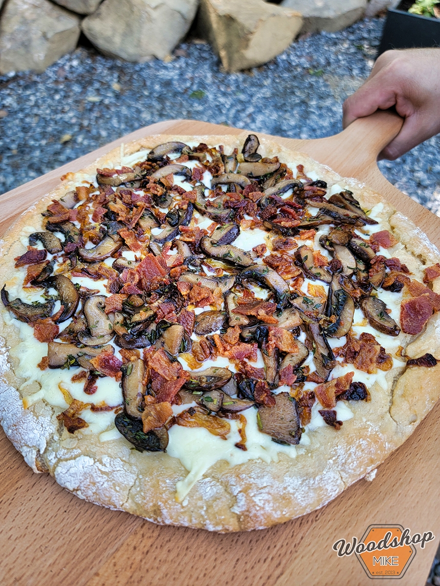Grilled Mushroom, Caramelized Onion, and Asiago Pizza with Fresh Herbs and Bacon