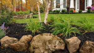 Front Landscape Renovation using natural boulders in Greece NY