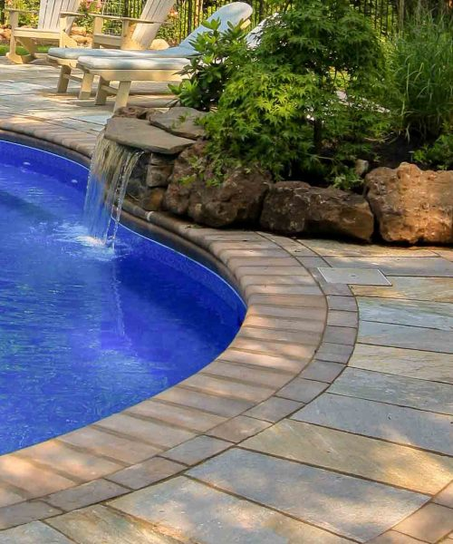 Boulders and natural stone landscape installation Rochester NY