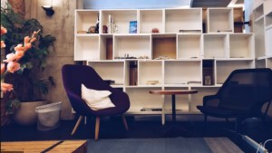 A Beautiful Bookcase Complementing an Armchair