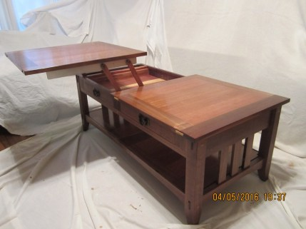 My coffee is of the Arts and Crafts style with a twist. The top is split and converts the table to a tray table.