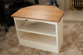 Here's my second TV Corner Cabinet, this time finished with eggshell paint for the pine base, and american white oak top finished with pure tung oil.