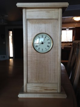 Christmas gifts for my daughters and their families. Matching wall clocks from black walnut and soft maple. Detailed with wooden molding planes.