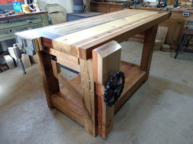Poplar, Walnut, Oak, Cherry Rosewood, Black Locust and Spruce are all used in this bench. Also the vise handles are upcycled horse drawn machinery sprockets.