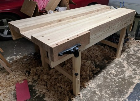 "Made from cheap Home Depot douglas fir 2x4s, with the exception of the vise that's cherry. The legs on the end with the vise are a bit further from the end for clearance (14""), and the well is only 9.5"" wide, but otherwise pretty much exactly like the older YouTube videos."