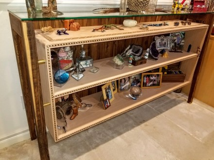 Art deco-inspired tri-material shelving featuring Bocote and inlaid European Beech for contrast. All wooden joinery.