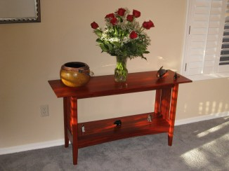 Craftsman style sofa table made out of paduak. It was put together with mortise and tenon joints.