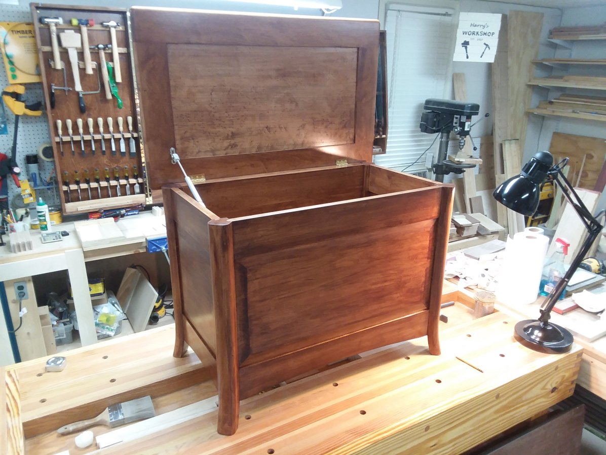 The blanket chest in hard maple with birdseye maple lid. The stain is General Finishes Brown Mahogany with oil-based polyurethane top coat.