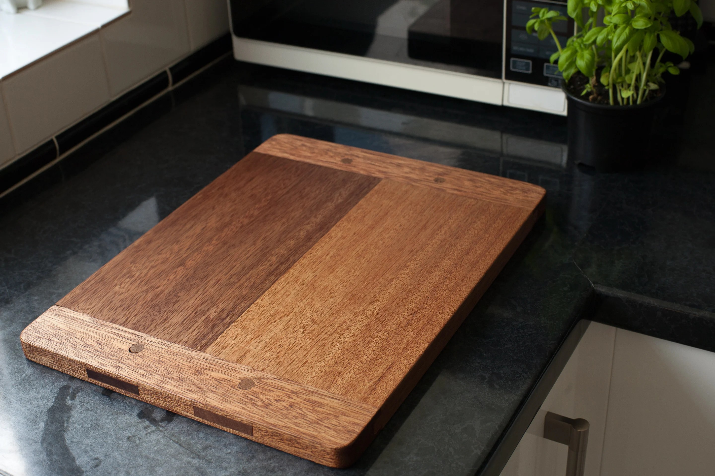 Breadboard End Cutting Board made using Meranti with Oak pins, finished with de-waxed shellac sanding sealer then tung oil.