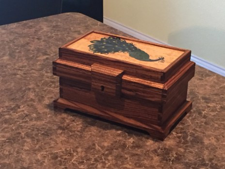 Zebra wood box with peacock marquetry