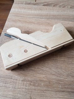 rebate plane with adjustable guide made in pine.
