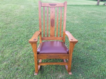 This is my second rocker with oak and walnut accents, built with some Greene and Greene details.