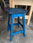 Bench stool made out of spruce. I finished it by staining it black, sanding most of it off and staining it once again with blue.