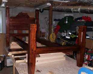70 plus pieces of laminated reclaimed pine, light brown dye, red mahogany stain, satin water based finish