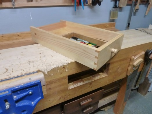 Workbench Drawer made of pine. All done with hand tools. Blind dovetails and housing dado with wedged through mortise like Paul showed in the 5 episode series.