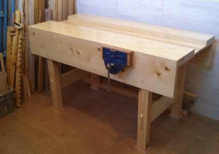 Here's my workbench. I made it from pine, finished it with polyurethane. It's really nice to finally have a solid workbench!