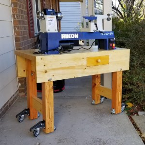 """As my dear old Mom used to say, now Paul see what you made me do! I will be 79 years old next month and had never been near a lathe but Paul gives me courage. I bought a """"bench"""" lathe but it's too heavy to put on and off my regular bench. I made a small version of Pauls bench to solve that problem--and even turned a knob from a Russian Olive branch cut down in my back yard a couple years ago."""