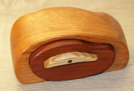 Inspired by bandsaw boxes on web, but made by hand tools only.. Made of beech, ash and plum wood.