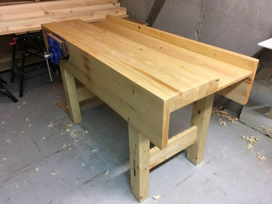 I made the new workbench and followed the design fairly closely. Made of SPF 2x4s and some eastern white pine for the aprons. It took so long to prepare all of the lumber with a handplane, but once that was done the bench came together fairly quickly. I love it!