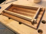 I made this wooden tray as Christmas gift for my sister's knitting needles and rings. The base is mahogany and the sides are maple. I finished with a coat of boiled linseed oil.