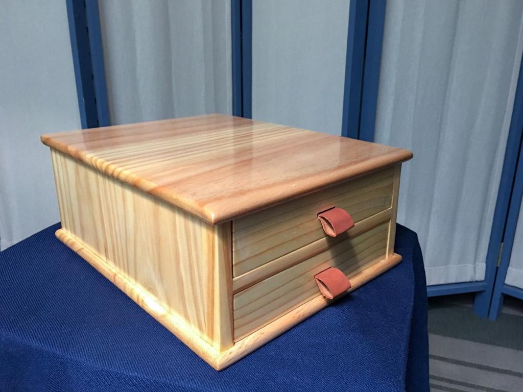 Paul's design, just scaled it a little bit. Made out of Pine, drawer bottoms and cabinet back included. Finished with tru-oil and padded shellac. I use it for storing my chisels.