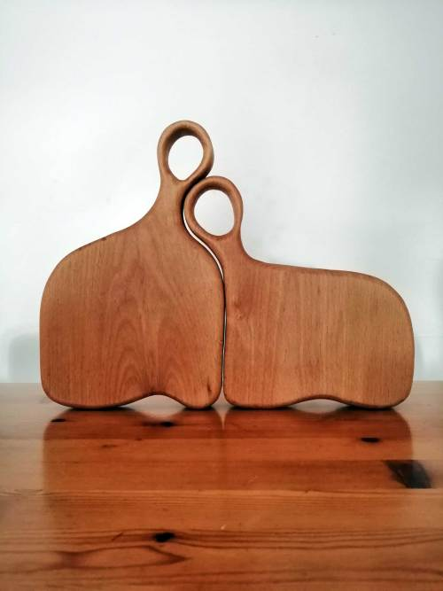 Happy couple chopping board